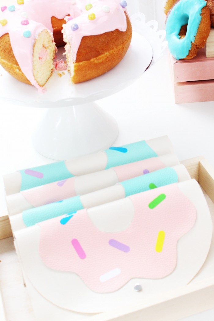 Pastel donut party with DIY awning, DIY donut clutches, and giant donut cake!