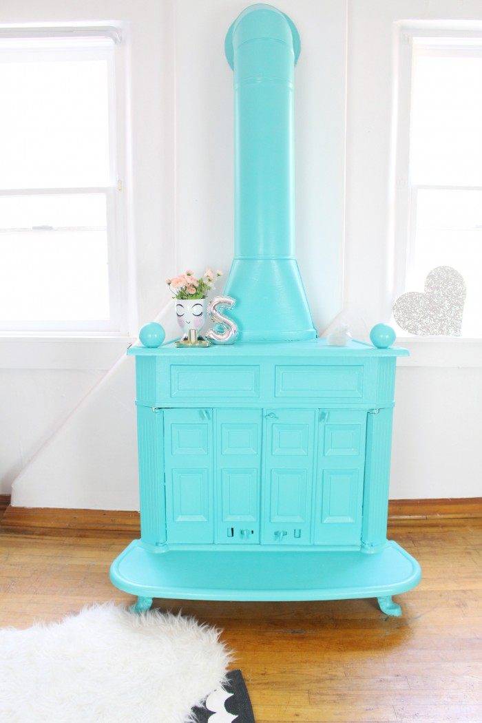Awesome turquoise wood burning stove, painted vintage fireplace