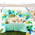 Modern Tropical 80th Birthday Party mixed turquoise, mint, blue, and gold balloon arch