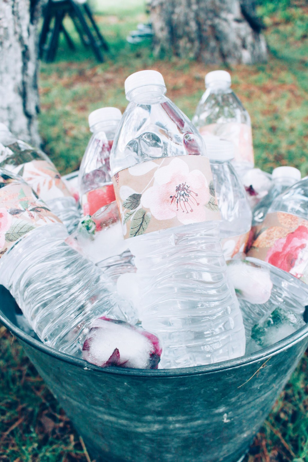 Custom water bottle wrappers featuring vintage florals and pink and rose gold bridal shower