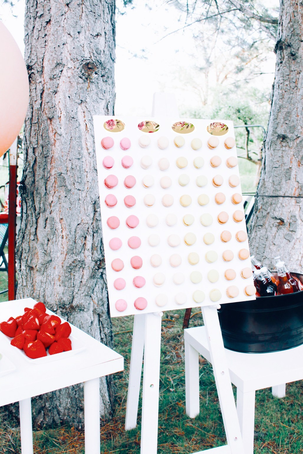 macaron wall at this pink and rose gold bridal shower