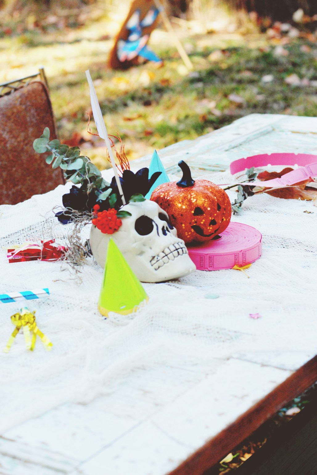 halloween carnival birthday party dollar store skull vases and colorful party elements