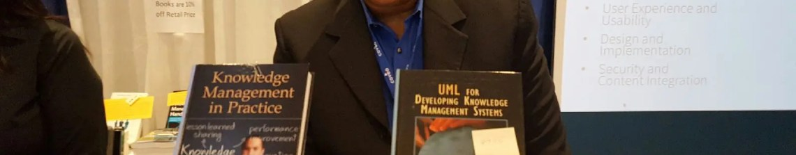 Dr. Anthony Rhem signs copies of his books at the KMWorld conference