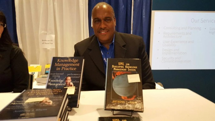 Dr. Anthony J. Rhem signs copies of his books at the 2016 KM World Conference
