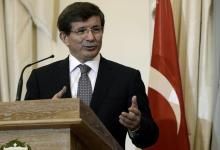 """صورة داود أوغلو: تركيا ستؤيد مشاركة إيران في """"جنيف-2"""""""