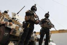 صورة القوات الامنية تنفذ عمليات دهم وتفتيش للمنازل والبساتين في قضاء الطارمية