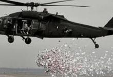 صورة الطيران العراقي يلقي الاف المنشورات على أهالي الموصل