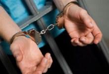 صورة القاء القبض على متهم بالاعتداء على مدرسة في ذي قار