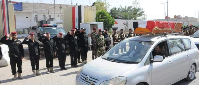 تشيع رسمي لشرطي في الناصرية سقط باحداث الجمعة (صور)