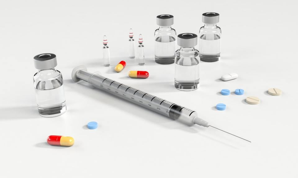 small glass tubes and syringes with white backgroung