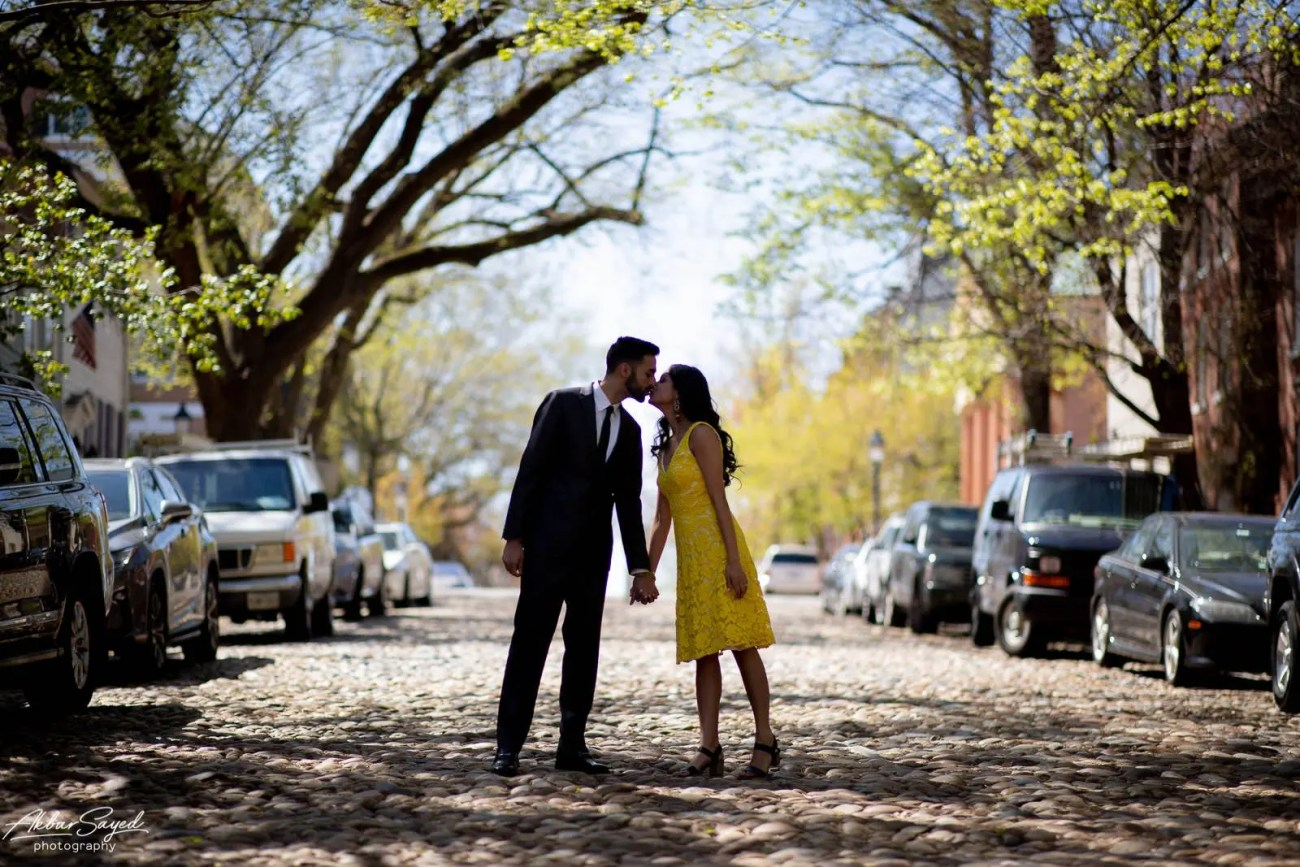 Old Town Alexandria engagement photo with an engaged Indian - American couple in a cobblestone street.