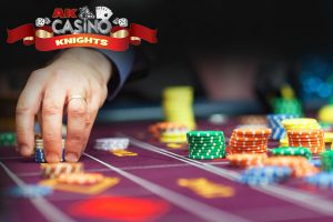 Fun casino roulette table with man placing chips