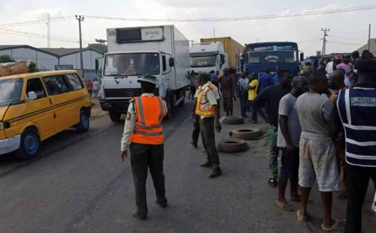 BREAKING: Six Dead While One Injured As Truck Falls On Car In Lagos