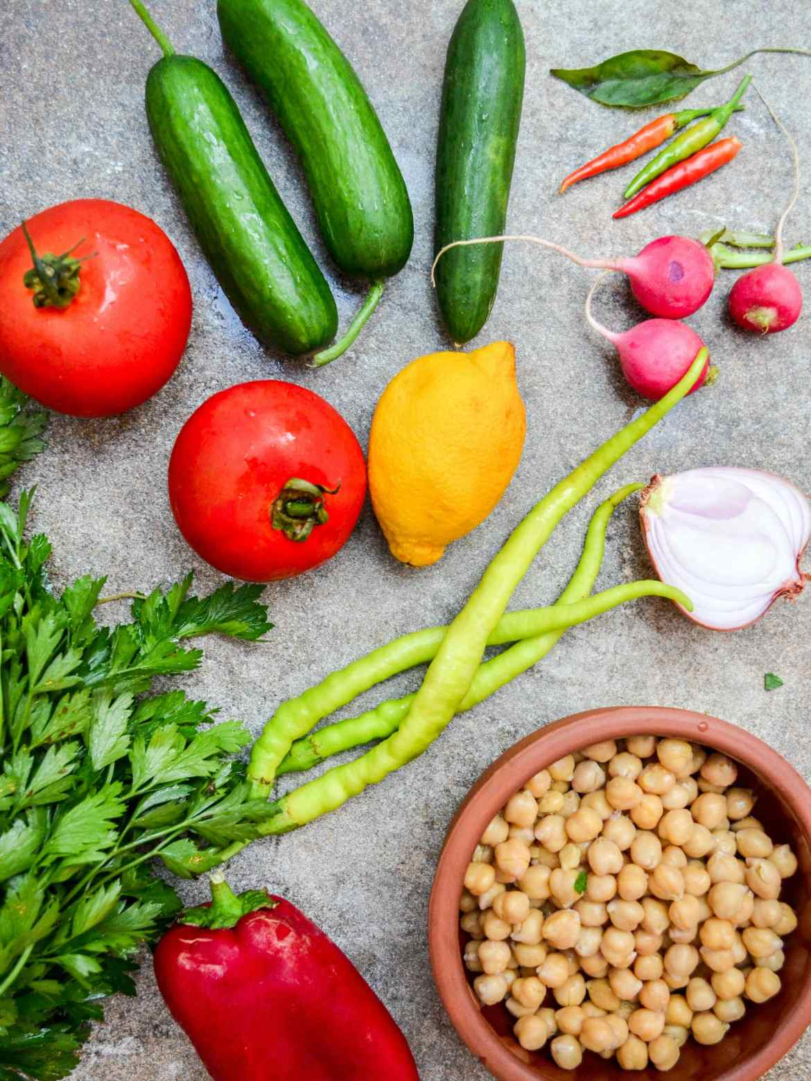 Vegetables for chopped vegetable salad with chickpeas and spicy dressing – A kitchen in Istanbul