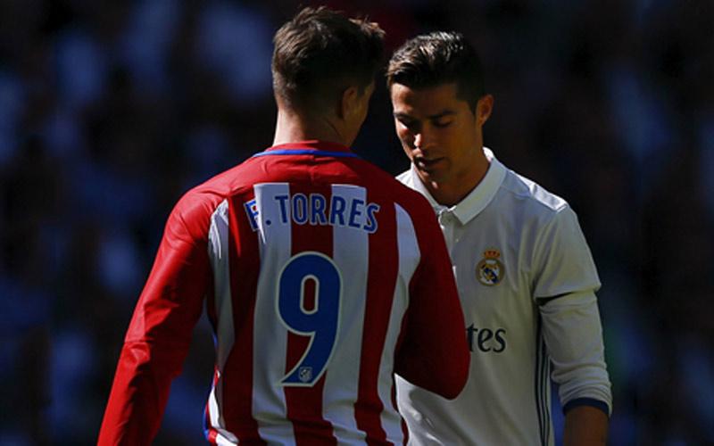 """صحف إسبانية: توريس وصف رونالدو ب""""المهرج"""""""