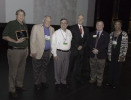 Officials from the city of Jacksonville receiving their re-certification award.