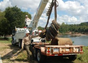 Tires are removed from a lake as part of a Renew Our Rivers cleanup. (contributed)
