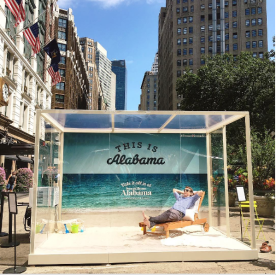 A display in New York City illustrates the relaxation that awaits a visitor to Alabama's beaches. (Contributed)