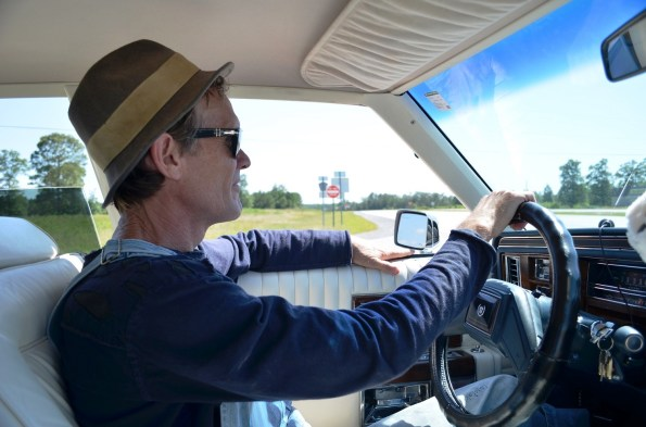 Butch Anthony drives the Loser Car to his Drive Thru Museum in Seale. (Anne Kristoff/Alabama NewsCenter)