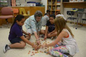 Putting pieces of the puzzle together. (Karim Shamshi-Basha/Alabama NewsCenter)