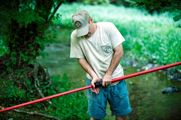 Researchers, biologists and trained bat lovers from across the Southeast prepare the mist nets to gently capture bats in the Talladega National Forest. (Chris Jones/Alabama NewsCenter)