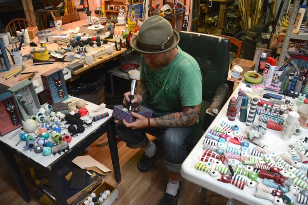 Chris Cumbie works on his latest CREEP at his mobile art studio. (Karim Shamsi-Basha/Alabama News Center)