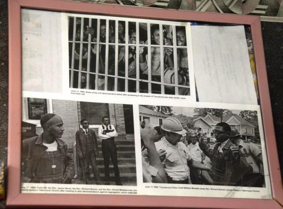 Civil rights memorabilia covers the walls of Linton's Barber Shop in Tuscaloosa. The shop itself is a civil rights landmark. (Karim Shamsi-Basha/Alabama NewsCenter)