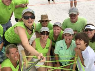 The Orange Beach Share the Beach team with a sea turtle nest that has been staked out. (Share the Beach)