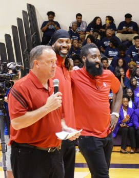 At Parker High School are, from left, Houston Rockets CEO Tad Brown, center Nenê and guard James Harden. (Michael Tomberlin / Alabama NewsCenter)