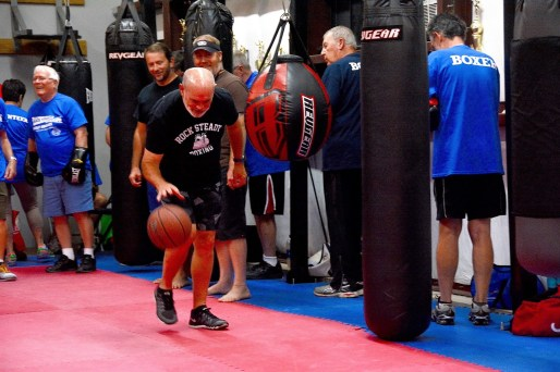Gary Ellis dribbles a basketball as a part of the routine at Rock Steady Boxing. (Karim Shamsi-Basha / Alabama NewsCenter)