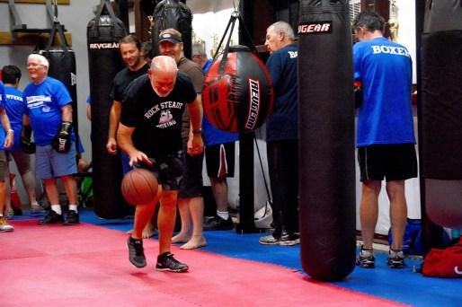 Gary Ellis dribbles a basketball as a part of the routine at Rock Steady Boxing. (Karim Shamsi-Basha / Alabama NewsCenter)