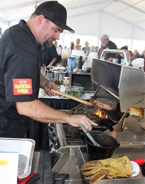 A competitor cooks steaks at the World Food Championships in Orange Beach. (Robert DeWitt / Alabama NewsCenter)