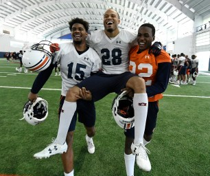 Auburn senior defensive back Tray Matthews (28) is carried off the practice field Dec. 21 during his final football practice in Auburn. (Todd Van Emst/AU Athletics)