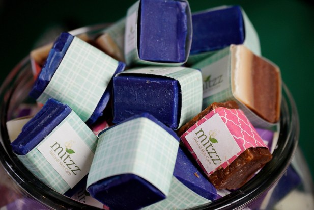 People respond to the all-natural composition of Mitzz Natural Skin Care products, but it's often the heavenly scents that reel them in. (Mark Sandlin / Alabama NewsCenter)