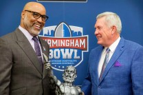 Former Alabama Crimson Tide and NFL linebacker Cornelius Bennett, left, received the 2017 Golden Flake Legend of Birmingham award and former Texas coach Mack Brown delivered the keynote reception at the Monday Morning Quarterback Club's Birmingham Bowl reception. (Birmingham Bowl)
