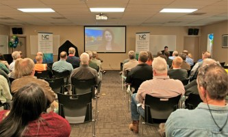 Southern Company Chief Operating Officer Kim Greene congratulates employees via video. (Billy Brown)