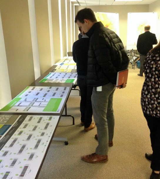 Members of the group working on the B Active plan examine maps of a proposed pedestrian and bicycling network. The materials will be presented to the public in a series of meetings beginning Tuesday evening. (contributed)