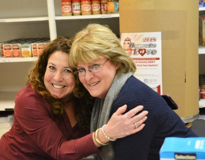 Wendy Taylor, left, founder of Barrels of Love with Gayle Monk at the Committee on Church Cooperation pantry. (Karim Shamsi-Basha / Alabama NewsCenter)