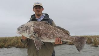 University of Montevallo student really reels in the big catch as part of the Outdoor Scholars Program. (Alabama NewsCenter file)