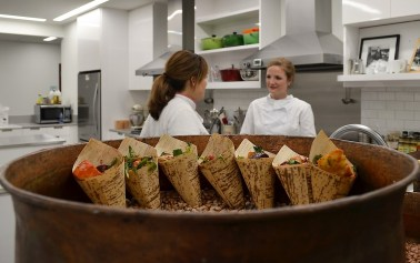 Elizabeth Heiskell, left, prepared panzanella salad with roasted root vegetables and homemade croutons, goat cheese and balsamic vinaigrette. (Michael Tomberlin / Alabama NewsCenter)
