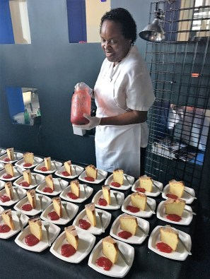 Dolester Miles adds strawberry preserves to her golden corncake. (Bob Blalock / Alabama NewsCenter)