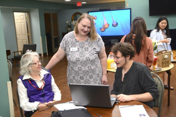 Catherine Findley, center, brought Cyber-Seniors to the CJSF and other Birmingham elderly communities. (Karim Shamsi-Basha / Alabama NewsCenter)