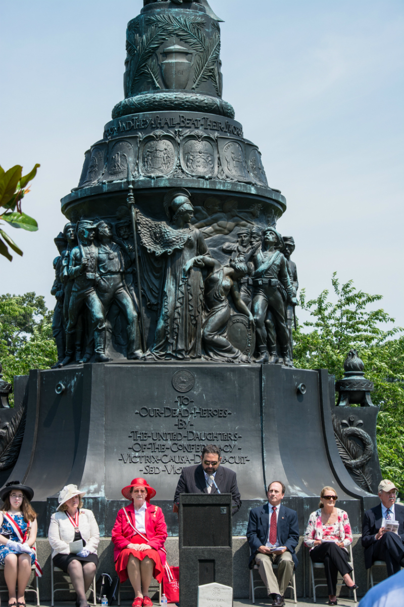 Dr. Stephen Carney, historian of Arlington National Cemetery, addresses the crowd at the Confederate Memorial Day exercises at the Confederate Memorial in Arlington National Cemetery in Arlington County, Virginia on June 8, 2014. Carney spoke about the historic significance of the memorial as a Confederate monument in what was then seen as a Union cemetery, and he briefly addressed how the memorial was seen as a monument to national unity. (Tim Evanson, Wikipedia)