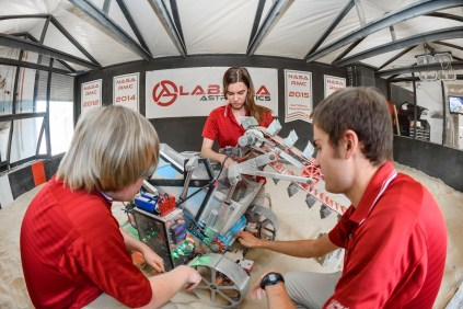 University of Alabama engineering students, from left, Max Eastepp, Rebecca Dietz and Curtis Mitchell work on the robot that students designed for a NASA contest. (University of Alabama)