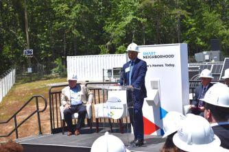 Alabama Power's Senior Vice President of Marketing and Business, John Hudson, speaks at the unveiling of the Smart Neighborhood program May 8. (Karim Shamshi Basha)