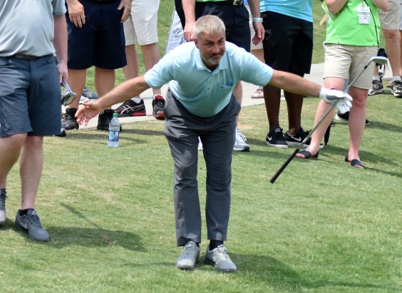 Singer Taylor Hicks takes a bow after his shot ricocheted onto the 18th green. (Solomon Crenshaw/Alabama NewsCenter)