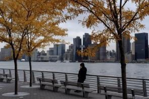The Manhattan skyline is seen as a pedestrian stands at Gantry Plaza State Park in the Long Island City neighborhood in the Queens borough of New York. (Christopher Lee/Bloomberg)