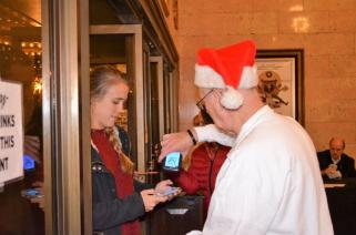 Tom Cronier scans tickets and greets visitors to the Alabama Theatre. (Michael Tomberlin / Alabama NewsCenter)