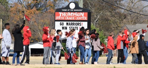 Students at Thompson Sixth Grade Center participate in the sendoff for the Thompson High School Warriors, who will play Central-Phenix City for the state 7A high school football championship. (Solomon Crenshaw Jr./Alabama NewsCenter)