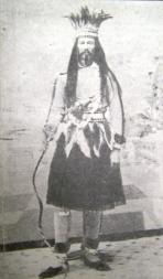 "Joe Cain dressed as Mardi Gras fictional character, ""Chief Slacabamorinico."" Photograph was taken prior to 1879. (University of South Alabama, Wikipedia)"